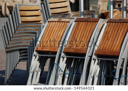 Cafe chairs stacked up