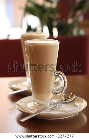 Cafe Coffee Latte in a glass with another one in background - stock photo