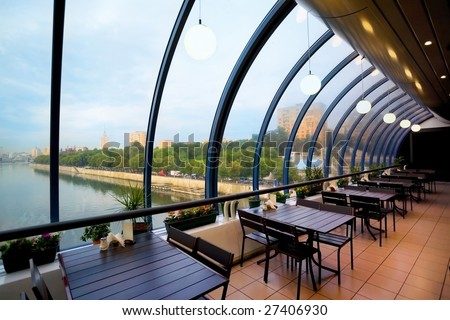 Cafe in some modern building and beautiful look from window - stock photo