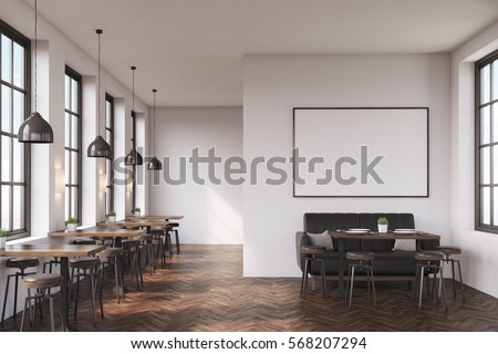 cafe interior with a large sofa near a white wall a row of tables with - Large Cafe Interior