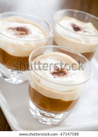 Cafe Latte in glass with spoon and sugar on plate - stock photo