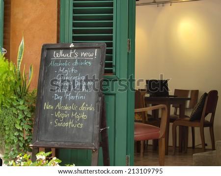 Cafe menu written in chalk on a blackboard - stock photo