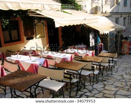 Cafe on the streets of old European city. Kerkyra Town, Corfu, Greece - stock photo