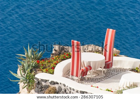 Cafe on the terrace with a beautiful sea view, Santorini island, Greece