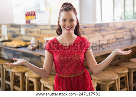 Cafe owner smiling at the camera at the cafe - stock photo