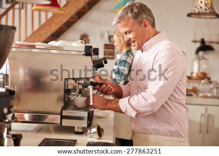 Cafe owners at work - stock photo