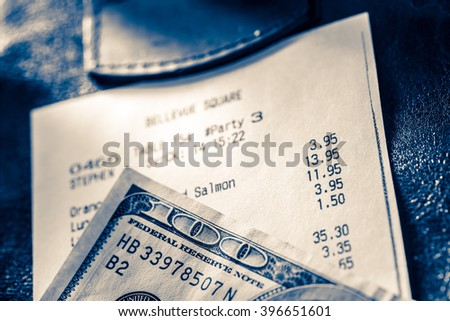 Cafe paper cheque with dollars in blue toning - stock photo