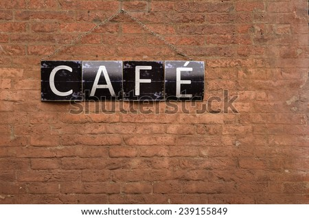 cafe sign on red bricks wall - stock photo