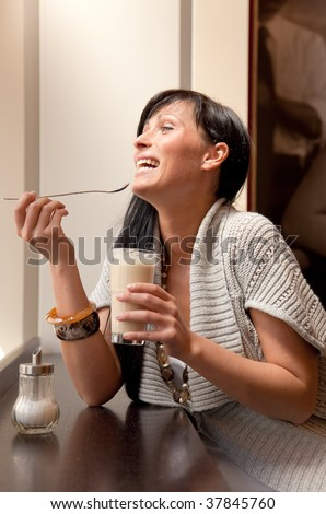 Cafe sitting woman smiling laughing while making a rest and drinking coffee - stock photo