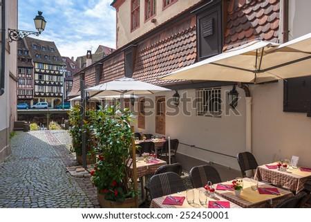 Cafe tables in Petite-France in Strasbourg. France, Alsace - stock photo