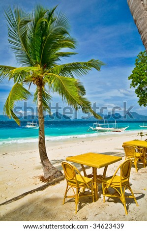 Cafe Tables on a Sunny Tropical Beach