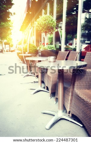 Cafe terrace in summer Paris - stock photo