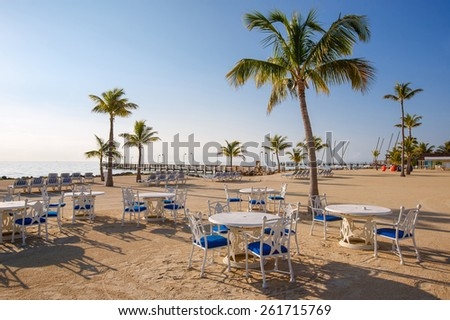 Cafe with beautiful view to the ocean on tropical coastline - stock photo