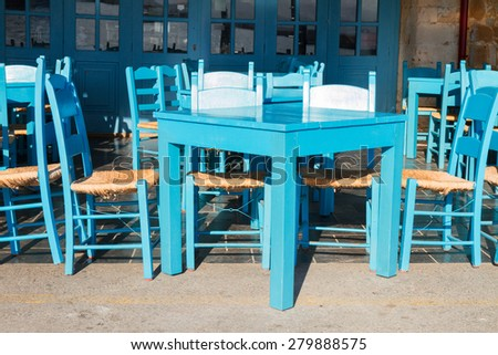 cafe with blue chairs on street of Chania old town, Crete, Greece - stock photo