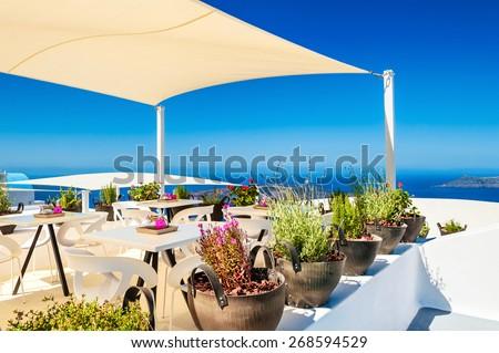 Cafe with sea view. Santorini island, Greece. Beautiful summer landscape - stock photo