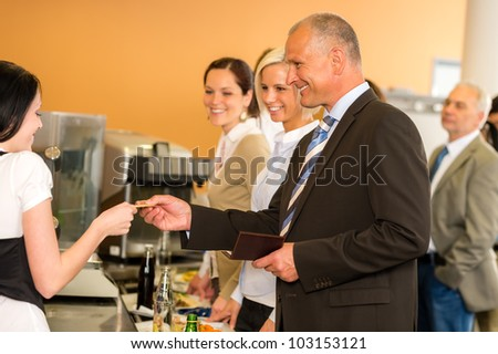 Cafeteria man pay by credit card cashier food on serving tray - stock photo