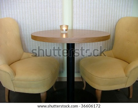 Cafeteria seating with two comfy armchairs - stock photo