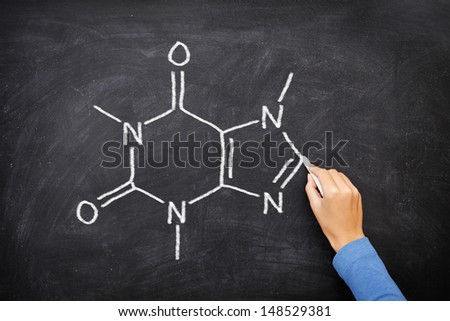 Caffeine chemical molecule structure on blackboard. Caffeine molecule drawing on chalkboard as it is found in coffee and tea etc. - stock photo