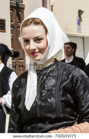 CAGLIARI, ITALY - MAY 1, 2016: 360 Feast of Sant'Efisio - portrait of a beautiful woman wearing a traditional Sardinian costume - Sardinia