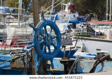 Cagliari: wheel of an old fishing boat anchored in the harbor of Marina Piccola - Sardinia - stock photo