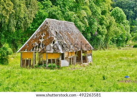 cailly, France - june 23 2016 : an old barn in a meadow