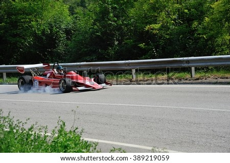 CAINO (BS), ITALY - JUNE 27: A red JCD Dino Formula 2 car takes part to the Nave Caino Sant'Eusebio race on June 27, 2015 in Caino (BS). The car was built in 1975. - stock photo