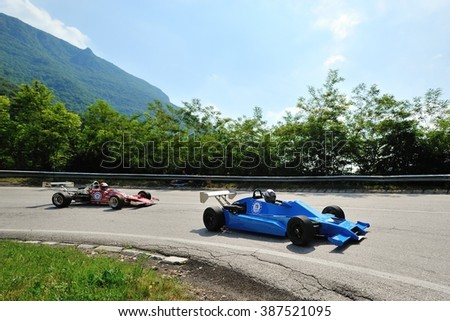 CAINO (BS), ITALY - JUNE 27: A vintage F3 car followed  by a red Formula Ford takes part to the Nave Caino Sant'Eusebio race on June 27, 2015 in Caino (BS). The cars were built in 1979 and 1975. - stock photo