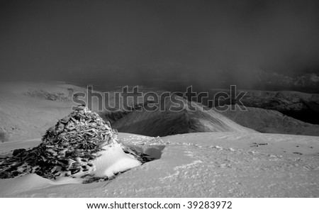Cairn at the summit of Swirral Edge on Helvellyn in the English Lake District - stock photo