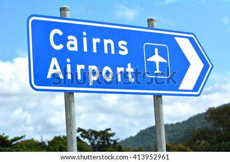 Cairns airport traffic sign in Queensland Australia against the Atherton Tableland mountains region. - stock photo