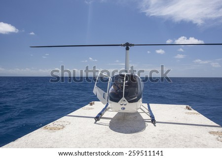 CAIRNS, AUSTRALIA - NOV 17: The helicopter on the floating platform for different water activities in Great Barrier Reef in Cairns, Australia on November 17 2011.  - stock photo