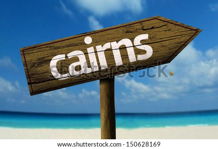 Cairns, Queensland, Australia wooden sign with a beach on background  - stock photo