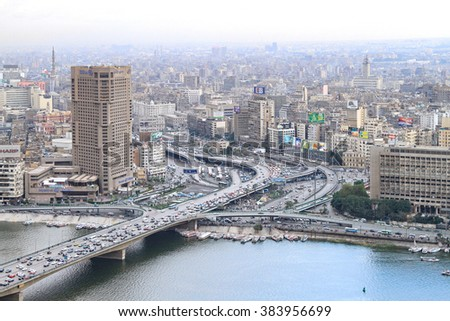 CAIRO, EGYPT - FEBRUAR 25: Cairo city from tower on FEBRUAR 25, 2010. City and bridge at River Nile in Cairo, Egypt. - stock photo