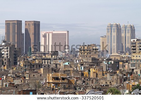 CAIRO, EGYPT - FEBRUARY 25: Downtown Cityscape in Cairo on FEBRUARY 25, 2010. Difference between poor and wealthy in central Cairo, Egypt. - stock photo