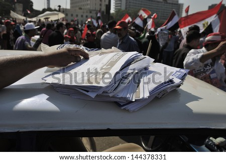 CAIRO, EGYPT - JUNE 30: Demonstration rebel movement (Tamarrod) signed applications which demand the resignation of the President Muhammad Morsi in Tahrir Square on June 30, 2013 in Cairo, Egypt - stock photo