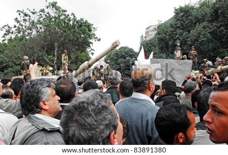 CAIRO - FEB 1: Egyptian anti-government protesters pass by an army checkpoint to enter Tahrir square. Cairo, Feb 1, 2011 - stock photo