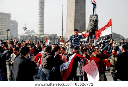 CAIRO - FEB 1: Groups of Egyptian anti-government protesters on their way to Cairo's central Tahrir Square. Cairo, Feb 1, 2011 - stock photo