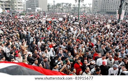 CAIRO - FEB 1: Hundreds of Egyptian anti-government protesters gather in Tahrir Square in Cairo, Egypt on Feb 1, 2011. - stock photo
