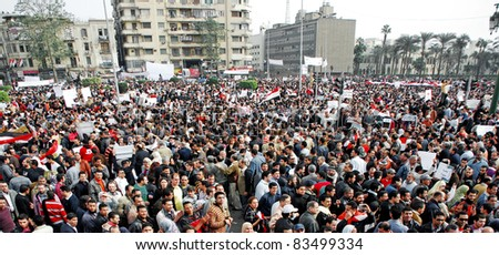 CAIRO - 01 FEBRUARY: Egyptian anti-government protesters gather in Cairo's central Tahrir Square. Cairo, Feb 1, 2011 - stock photo