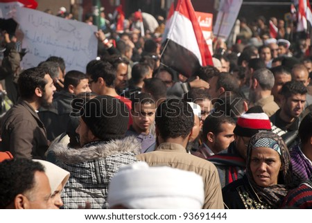 CAIRO – JAN 25: Thousands of Egyptians gather in Cairo's Tahrir Square on the first anniversary of Egyptian uprising to call for further political reforms in Cairo, Egypt on January 25, 2012 - stock photo