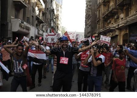 CAIRO - JUNE 30: Anti Muslim Brotherhood/Morsi protesters in Tahrir street shout slogans calling for Morsi's resignation on June 30, 2013 in Cairo, Egypt.