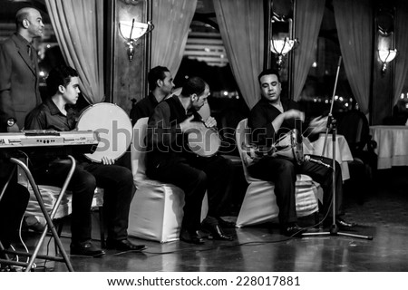 Cairo - Oct 2014: A band plays music for a dinner cruise and live performance show over the Nile River on Oct 14, 2014 in Cairo, Egypt - stock photo