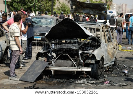 CAIRO - SEP 05: One of the exploded cars belonging to the interior minister's convoy after the explosion that was targeting the Interior Minister in Mostafa Nahas st Cairo, Egypt on September 05, 2013
