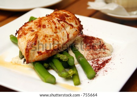Cajun chicken with buttered asparagus - stock photo