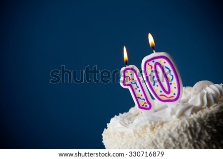Cake: Birthday Cake With Candles For 10th Birthday - stock photo