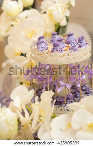 Cake, candies, marshmallows, cake, fruits and other sweets on dessert table. - stock photo