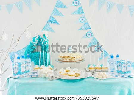 Cake, candies, marshmallows, cakepops for 4th birthday party, focus on candle - stock photo