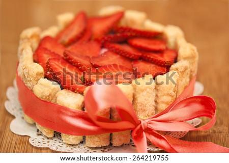 "Cake ""Charlotte"" with strawberry and cream - stock photo"