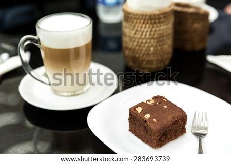 Cake chocolate brownies and coffee latte, chocolate brownie - stock photo