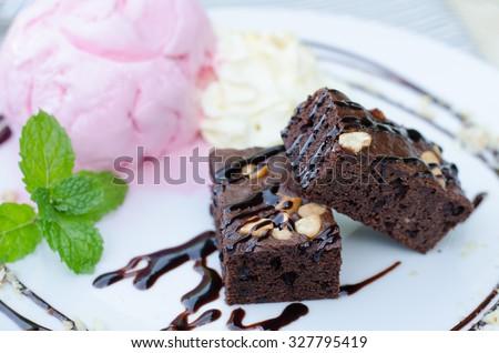 Cake chocolate brownies on ice cream - stock photo