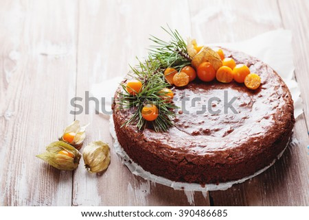 Cake chocolate brownies on wooden background decorated with physalis selective focus - stock photo